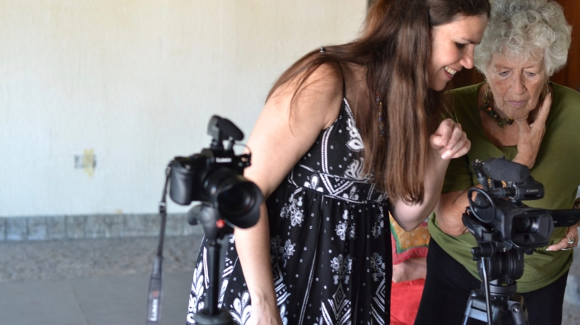 Alexandra Hidalgo shows her aunt Yarima Hidalgo how the cameras work while film A Family of Stories